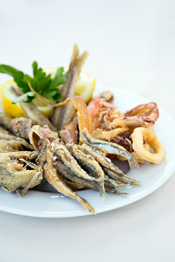 Italian mixed fried fish stock image