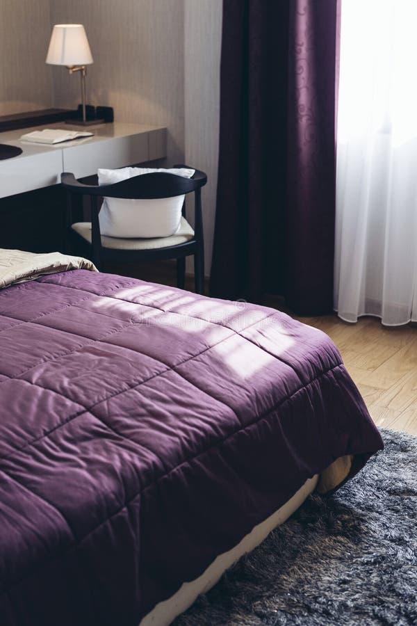Italian Modern Model House : Purple Blanket Detail in Bedroom royalty free stock photos
