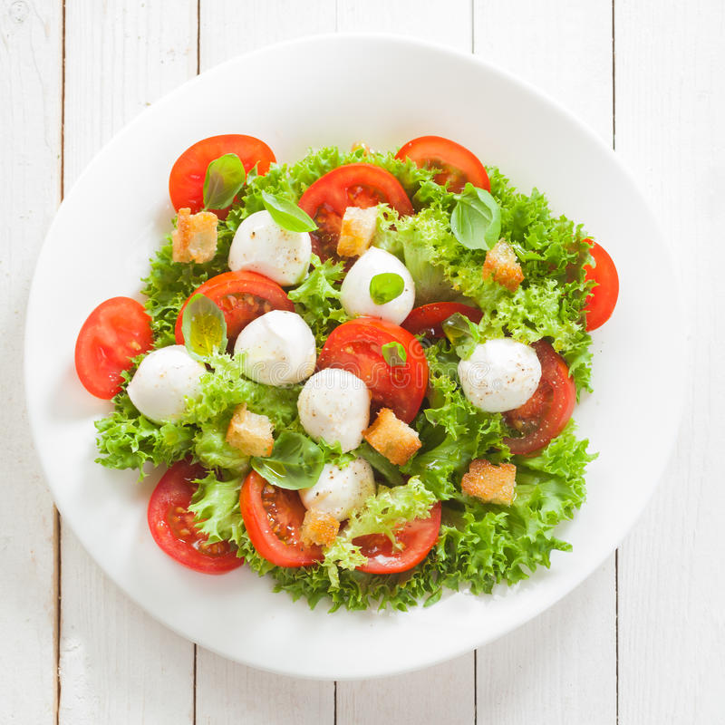 Italian mozzarella cheese and tomato salad stock photography
