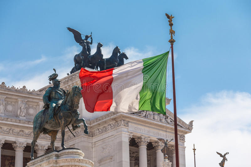 Italian national flag in front of Altare della Patria royalty free stock photo