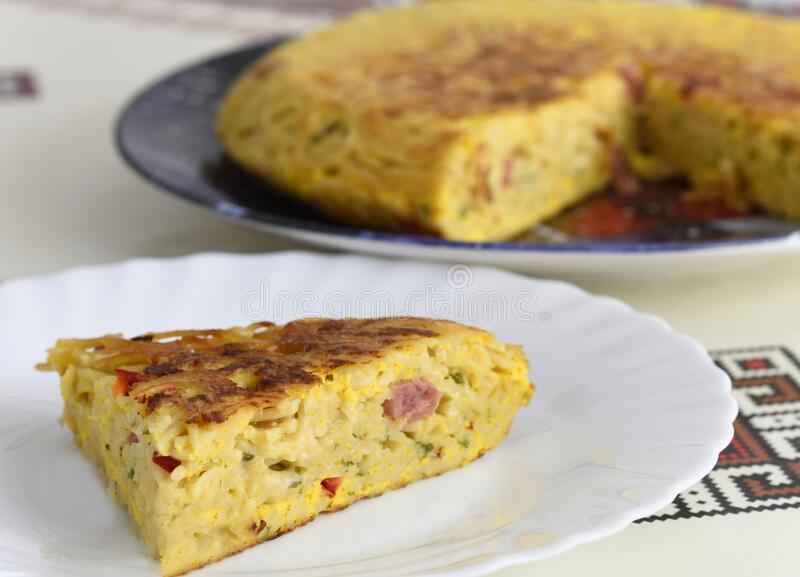 Italian omelet of pasta made with spaghetti and speck stock image
