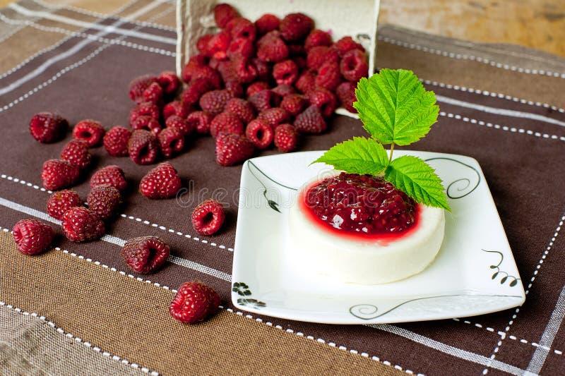 Italian panna cotta. Panna cotta - italian dessert with raspberries and jam stock photography