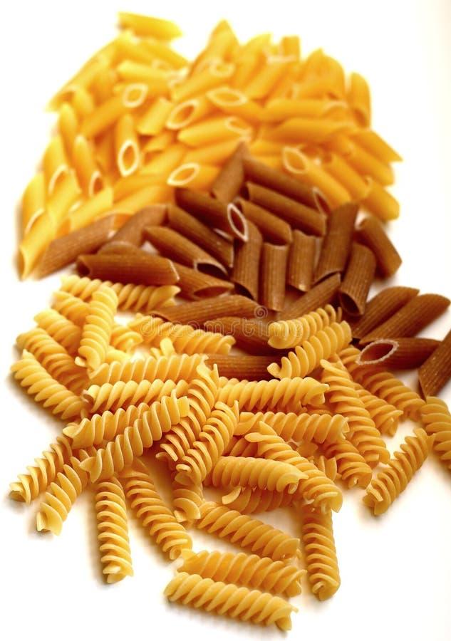 Italian pasta. Delicious raw italian pasta tipes royalty free stock photos