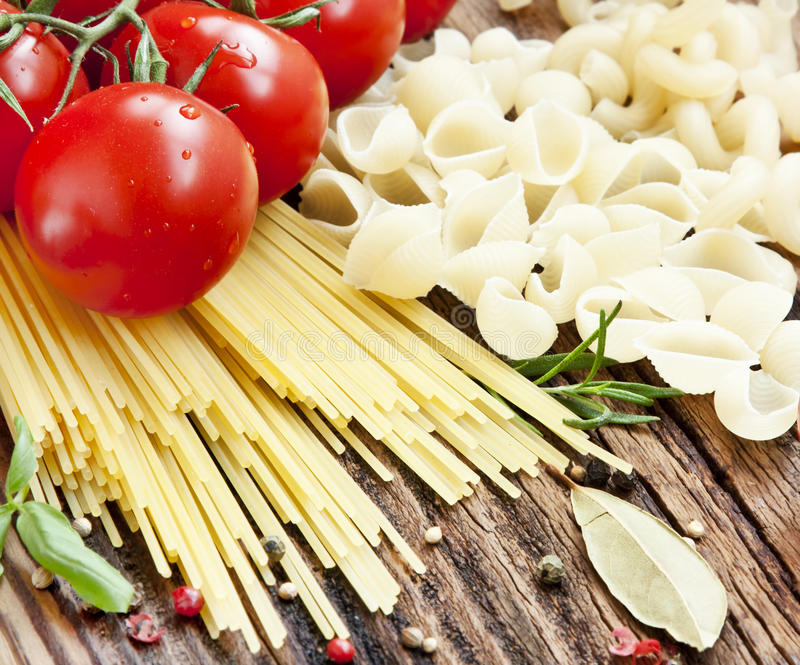Italian Pasta with Cherry Tomatoes and SPices. On Wooden Background royalty free stock images