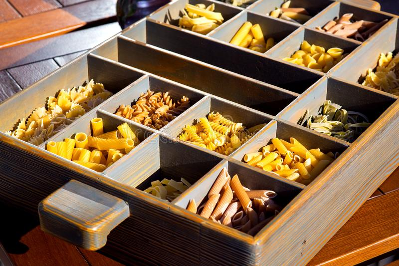 Italian pasta collection in wooden box. royalty free stock photo