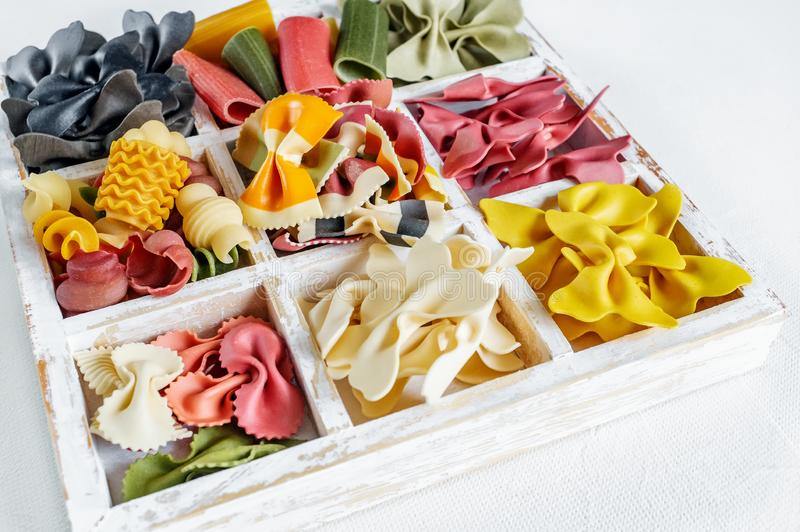 Italian pasta collection in wooden white box on light background royalty free stock image