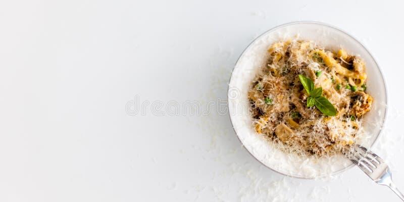 Italian pasta dish. Pollo alle tetrazzini or chicken tetrazzini. It contains fettucine, basil, parmesan, peas. It's a pasta bake royalty free stock photos