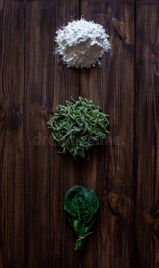 Italian pasta and ingredients for cooking. Wooden background stock photo