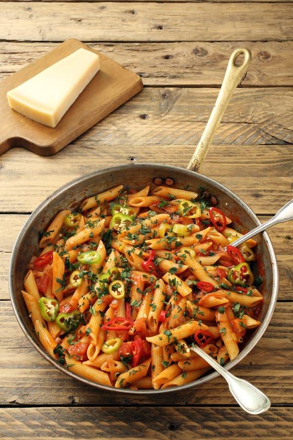 Italian pasta. On rustic background stock photo