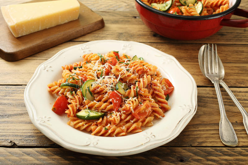 Italian pasta. On rustic background stock images