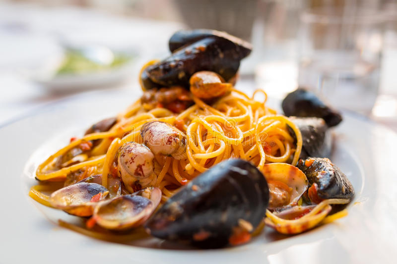 Italian pasta with seafood. And herbs royalty free stock images