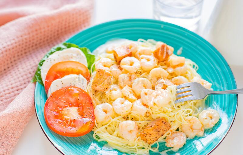 Italian Pasta with shrimps and creamy sauce stock images