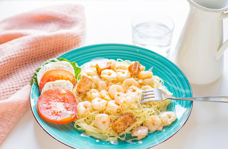 Italian Pasta with shrimps and creamy sauce royalty free stock photos