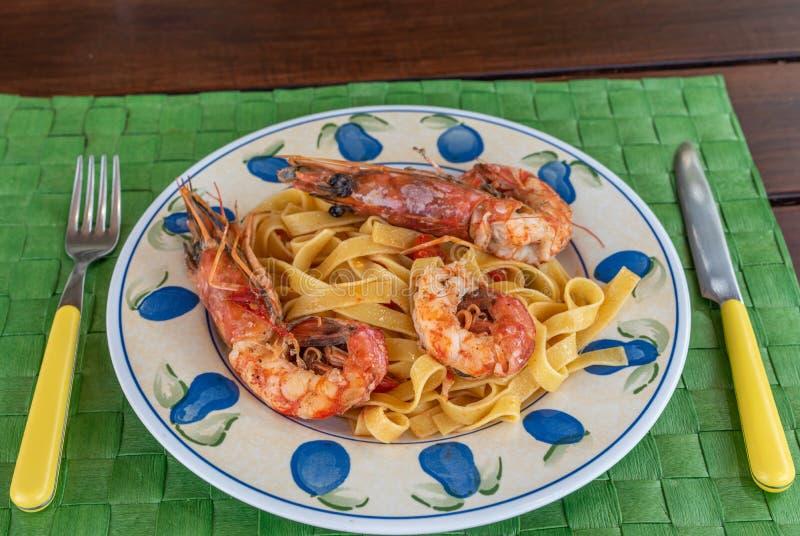 Italian pasta with shrimps stock image