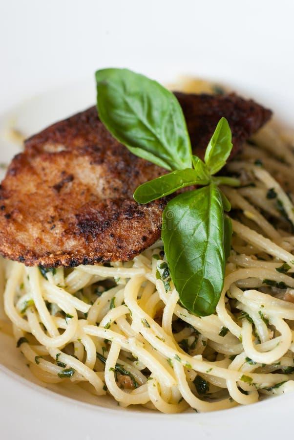 Download Italian Pasta Spaghetti With Pesto Sauce And Striped Bass Stock Photo - Image of food, fresh: 39502866