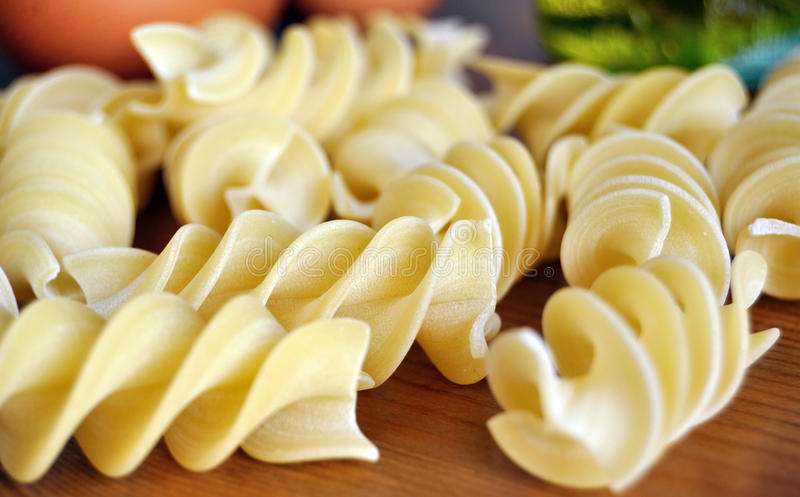 Italian pasta specialty. Italian spiral pasta specialty on a wooden table stock photography