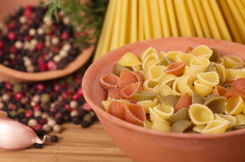 Italian pasta with spices and garlic stock images