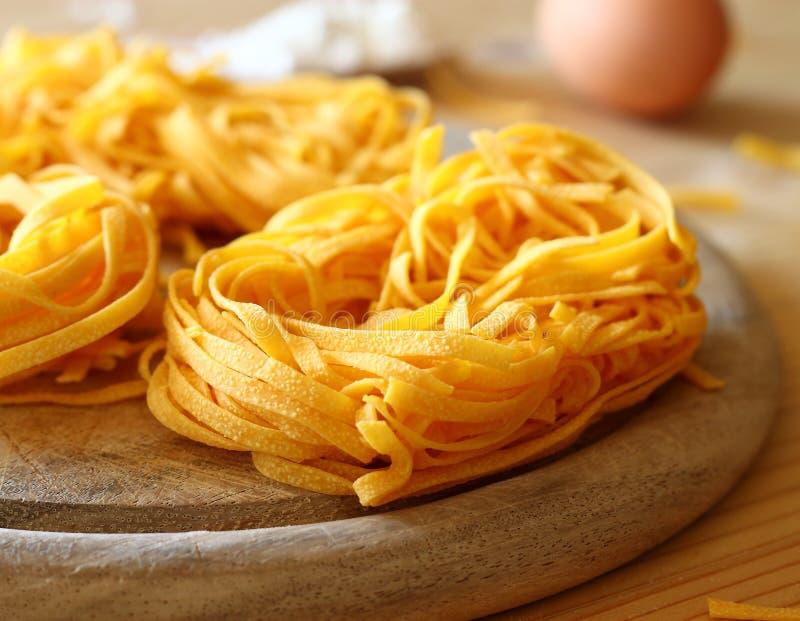 Italian pasta tagliatelle. Uncooked delicious italian pasta tagliatelle stock image