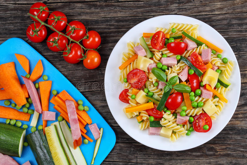 Italian pasta with vegetables on plate royalty free stock photography