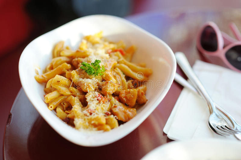 Italian pasta on white plate royalty free stock photography