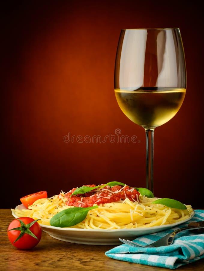 Italian pasta and white wine stock images