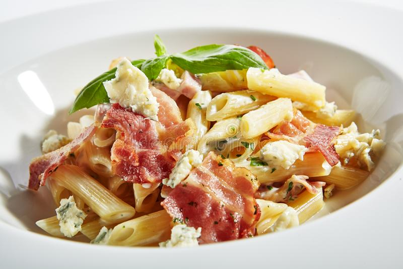 Italian Penne Pasta with Bacon and Blue Cheese Close Up royalty free stock images