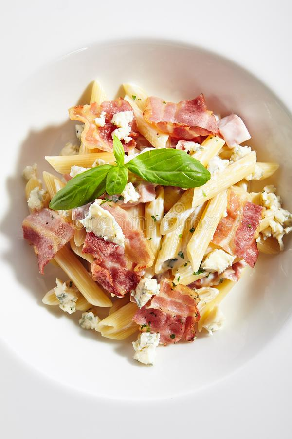 Italian Penne Pasta with Bacon and Blue Cheese stock photography
