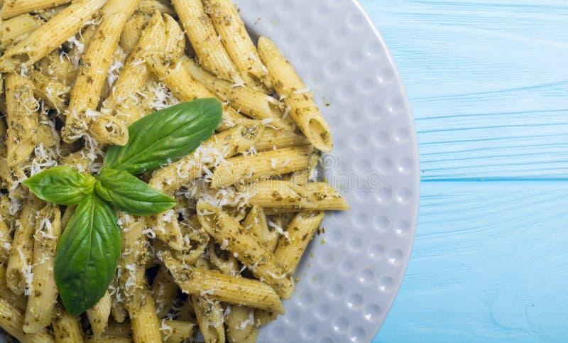 Italian penne pasta with sauce pesto Food background. Italian penne pasta with sauce pesto . Food background royalty free stock image