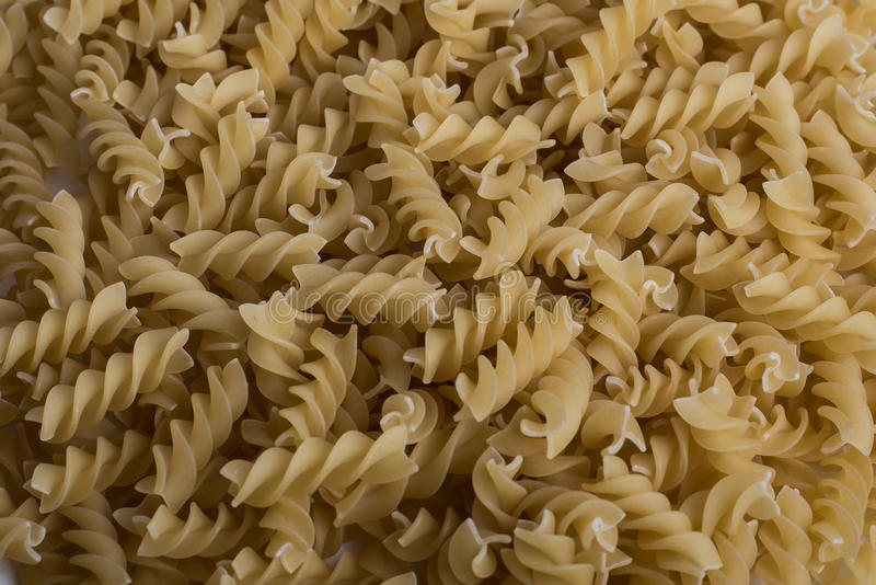 Italian Penne Rigate Macaroni Pasta raw food background or texture stock photography