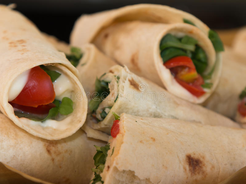 Italian Piadina Rolled and Filled with Cheese, Tomato and Argula: Typical Italian Flat unleavened Bread royalty free stock photography