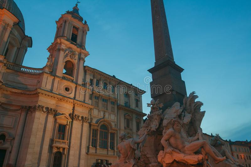 Italian Piazza Navona with Fountain of the Four Rivers and Sant Agnese church in Rome. Outdoors stock photo
