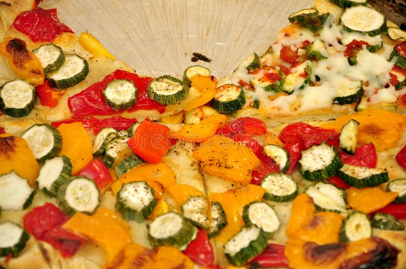 Italian vegetarian pizza with zucchini and peppers stock photos