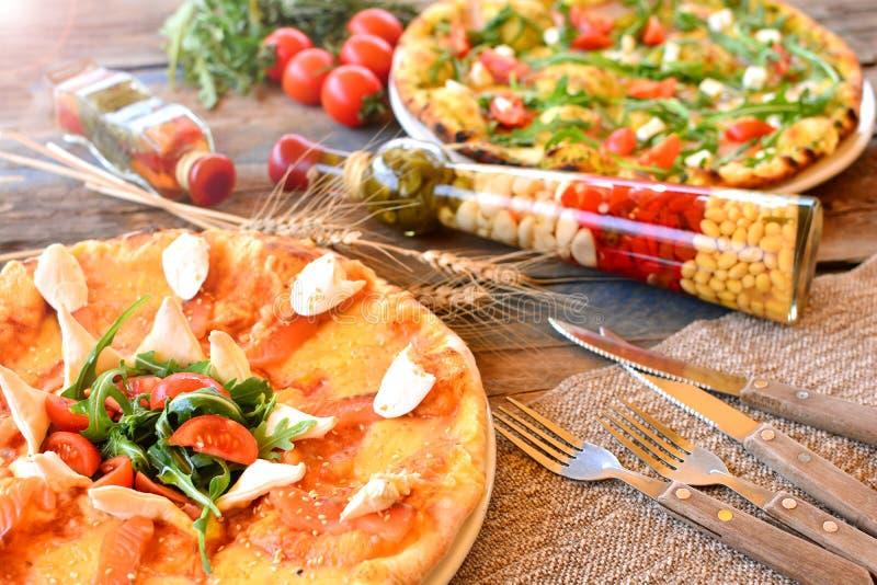 Italian pizza background. Rustic cuisine. Italian pizza background. Rustic cuisine royalty free stock images