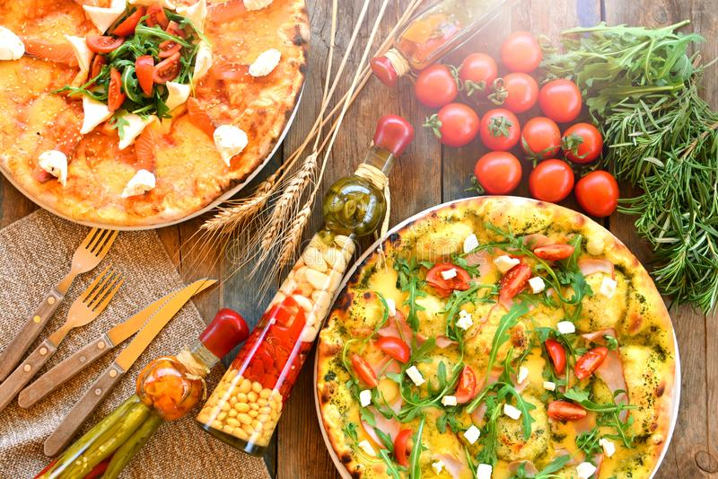 Italian pizza cuisine flat lay, top view. Italian pizza cuisine flat lay, top view royalty free stock photography