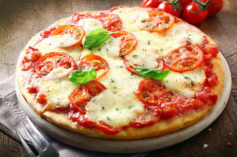 Italian pizza with melted cheese stock photos