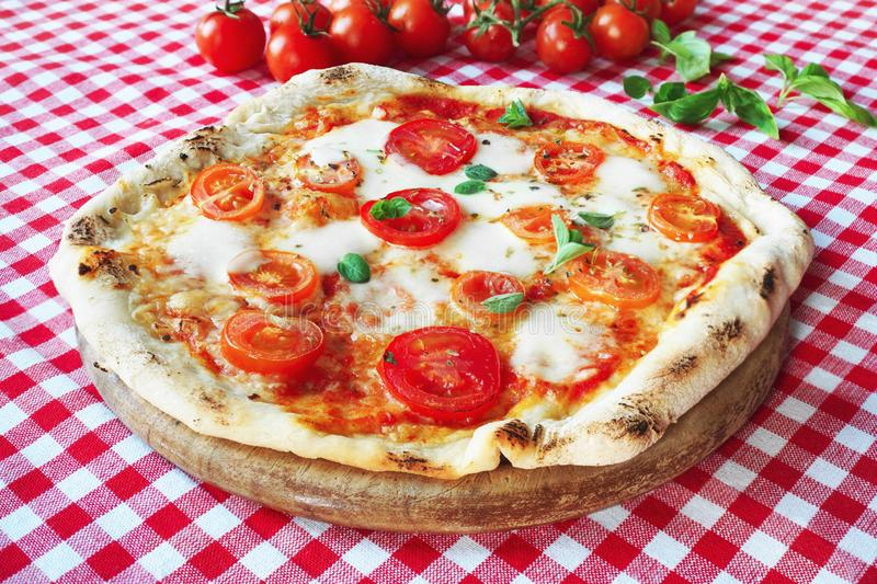 Italian Pizza with Mozzarella, tomatoes and basil royalty free stock images