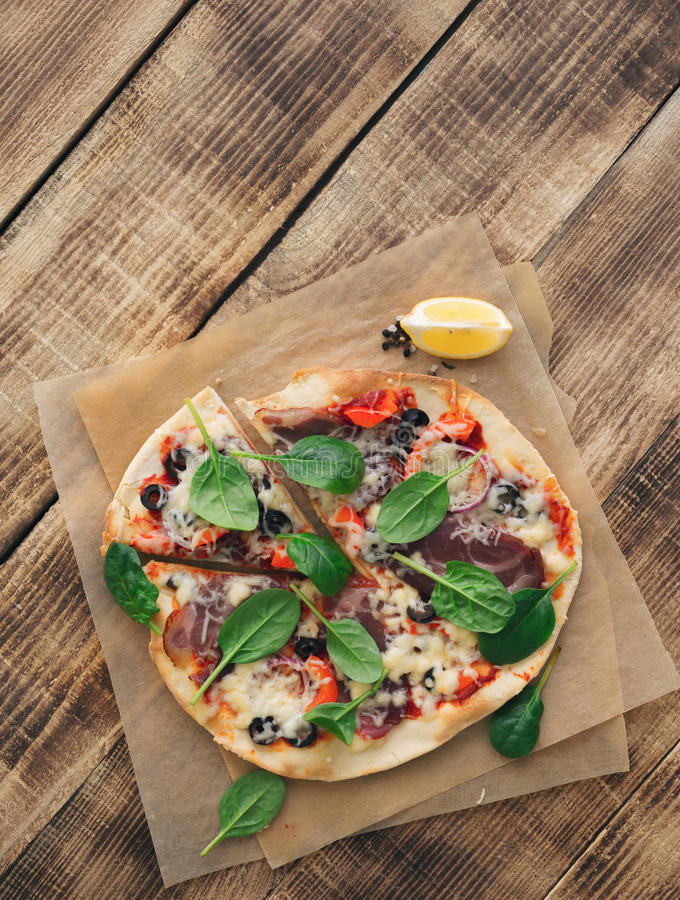 Italian pizza on wooden table close up, top view royalty free stock image