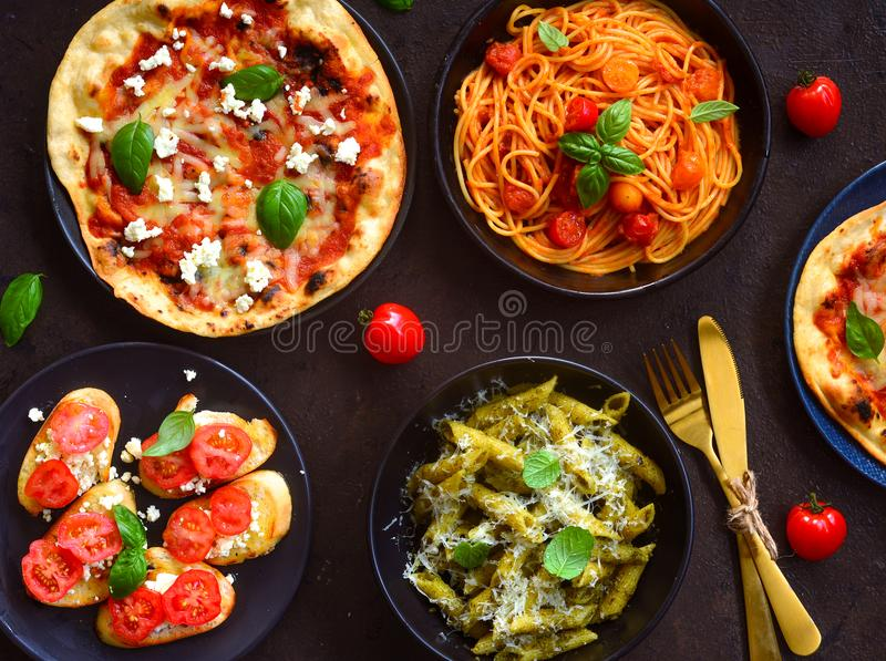 Italian platter-arrabiata spaghetti,alfredo pasta aglio olio ,bruschetta and margarita pizza stock image