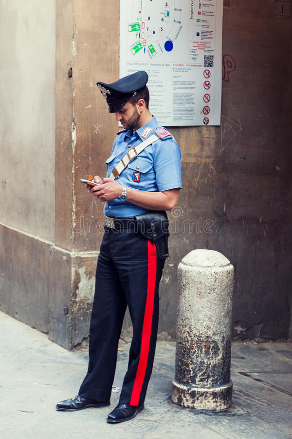 Italian policeman standing on the street stock photos