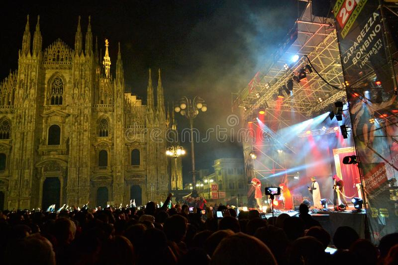 Italian popular rapper Caparezza is singing during the New Year`s concert. Milan, Italy-January 1, 2016:The Italian popular rapper Caparezza is singing during royalty free stock images