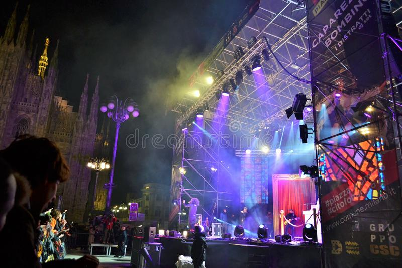 Italian popular rapper Caparezza is singing during the New Year`s concert. Milan, Italy-January 1, 2016:The Italian popular rapper Caparezza is singing during royalty free stock image