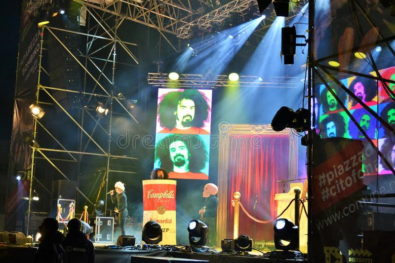 Italian popular rapper Caparezza is singing during the New Year`s concert. Milan, Italy-January 1, 2016:The Italian popular rapper Caparezza is singing during stock photo