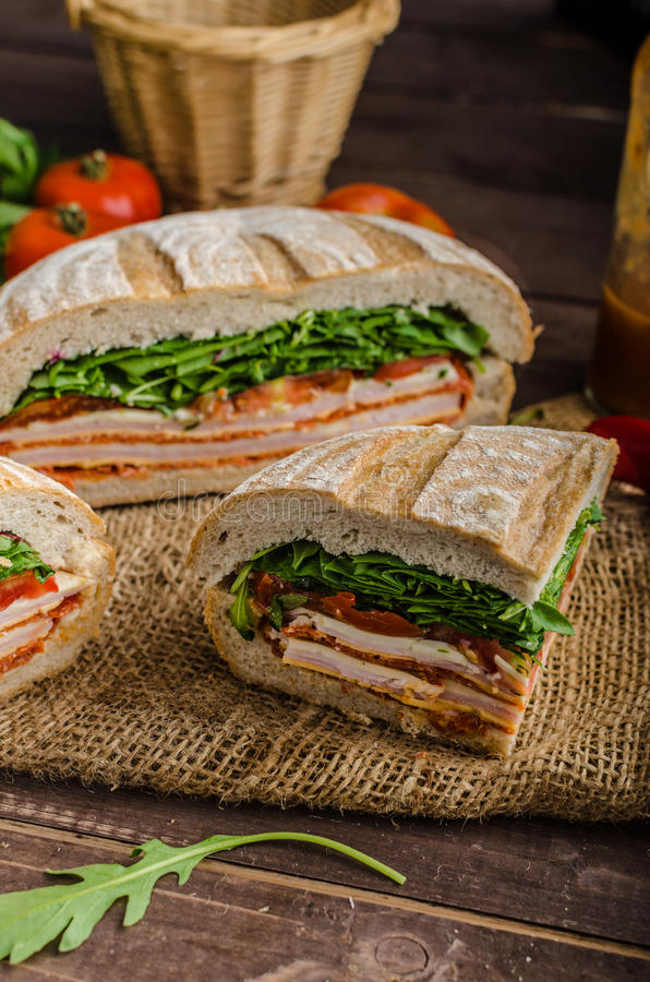 Italian Pressed Sandwich. Full of tasty. Italian ham and cheese, spinach, homemade chips side dish royalty free stock photography