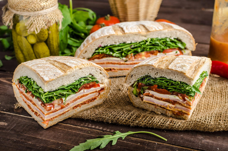Italian Pressed Sandwich. Full of tasty. Italian ham and cheese, spinach, homemade chips side dish stock photos