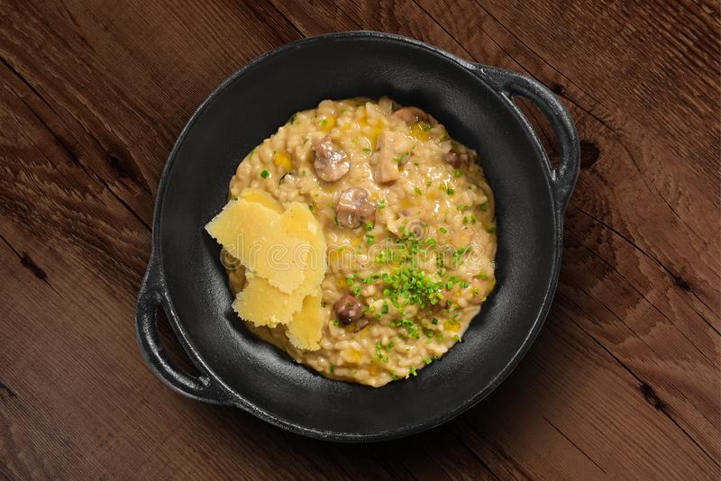 Traditional Italian risotto on black rustic pan stock image