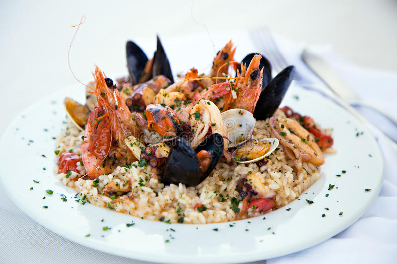 Italian risotto with shrimps, mussels, octopus and clams stock image