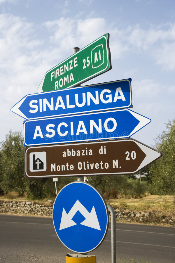Italian road signs. Road signs pointing different directions in Tuscany, Italy stock photography