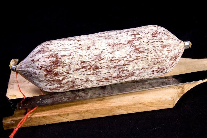 Italian salami. On wooden cutting board royalty free stock photos