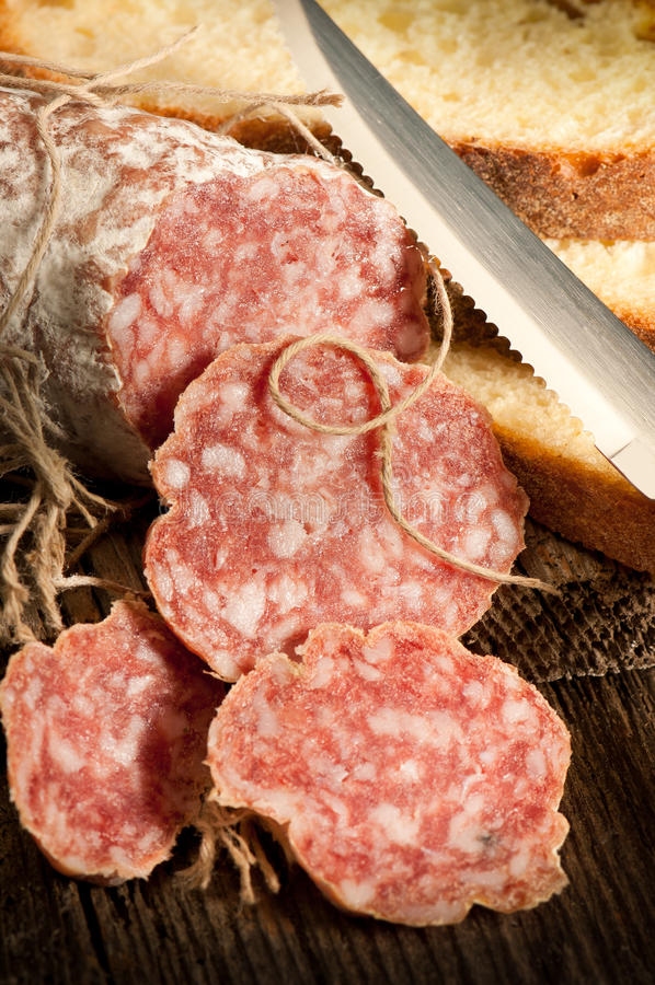 Italian salami with slice bread royalty free stock image