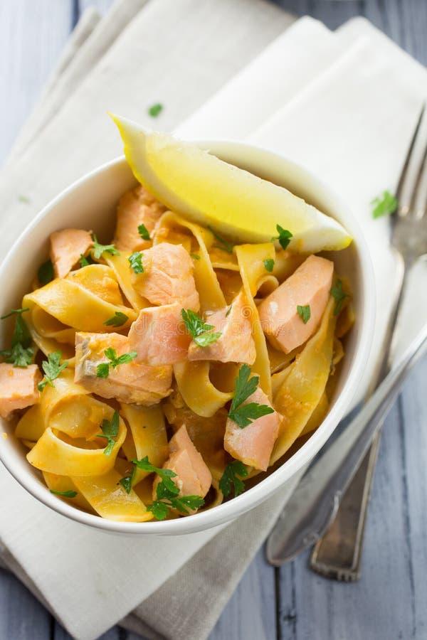 Italian salmon and lemon pasta royalty free stock photos